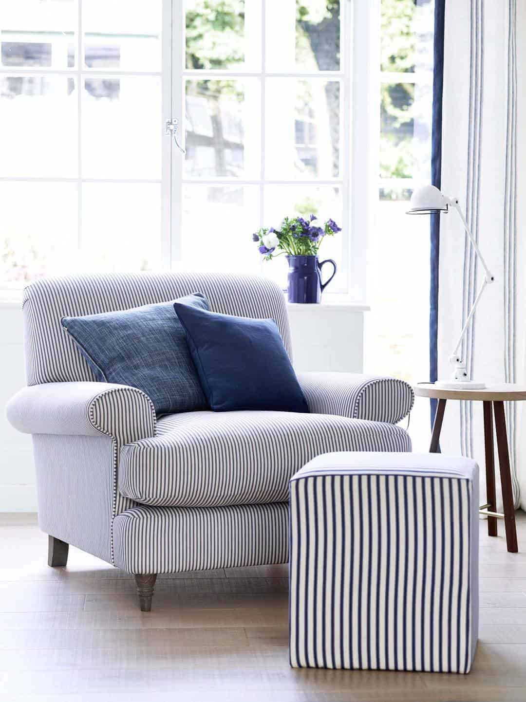 love this nautical blue and white stripe linen covered chair by ian mankin. Click through to get easy step by step DIY tutorial on how to upholster or upcyle your own chair and to find out more about this ethically produced fabric made in Britain as well as other beautiful fabrics you'll love