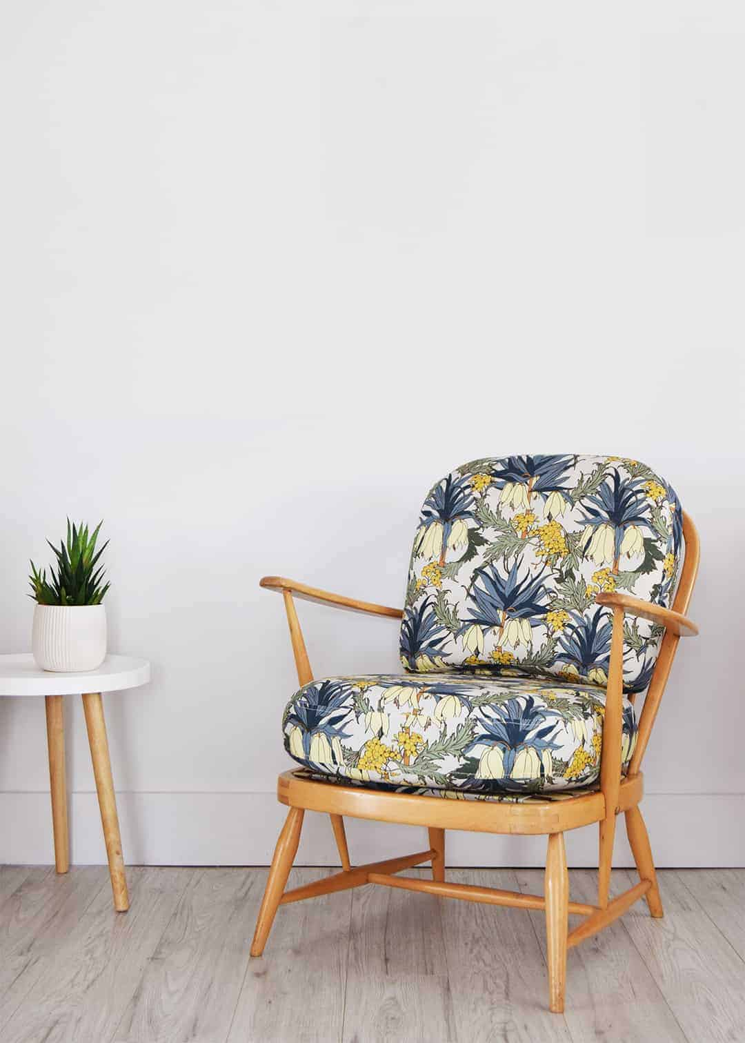 love this ercol chair reupholstered with bold floral linen fabric by Abigail Borg. Click through to get easy step by step DIY tutorial on how to upholster or upcyle your own chair and to find out more about this ethically produced fabric made in Britain as well as other beautiful fabrics you'll love