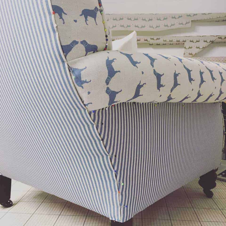 love this idea - how to reupholster and armchair using labrador print Olive + Daisy blue and natural linen with blue and white stripe. Click through to get easy step by step DIY tutorial on how to upholster or upcyle your own chair and to find out more about this ethically produced fabric made in Britain as well as other beautiful fabrics you'll love