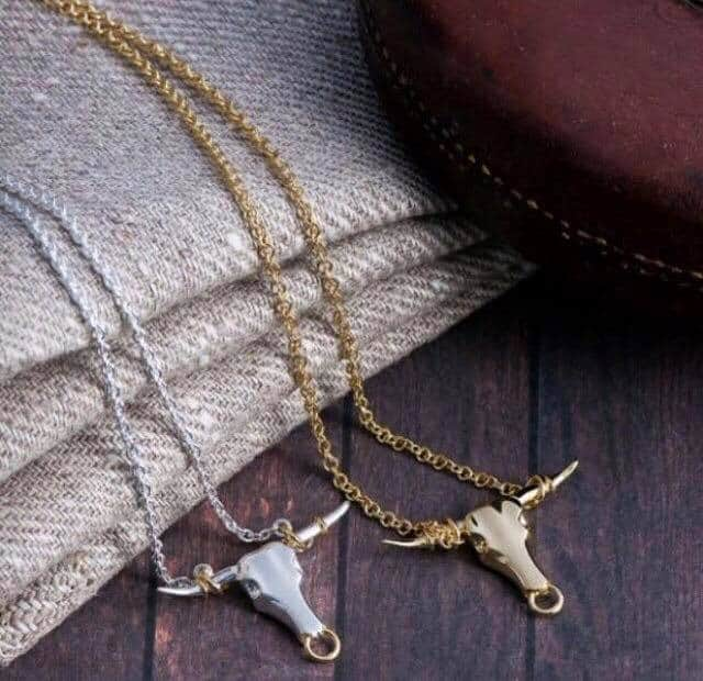 love these silver and gold handmade longhorn necklaces by pearl and queenie