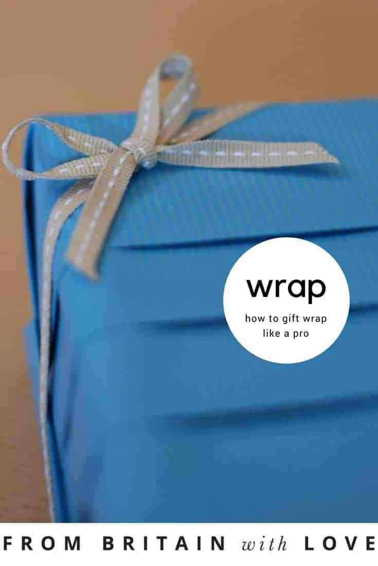 love this pleated blue paper gift wrap idea with perfect bow by Jane Means. Click through for more ideas you'll love