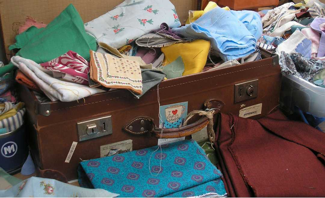 suitcase full of vintage fabric