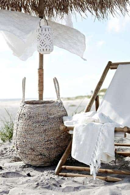 love this contemporary coastal style combination of white hamman throw, white lantern, white shade and natural wood deckchair. Seaside outdoor living in white and natural shades