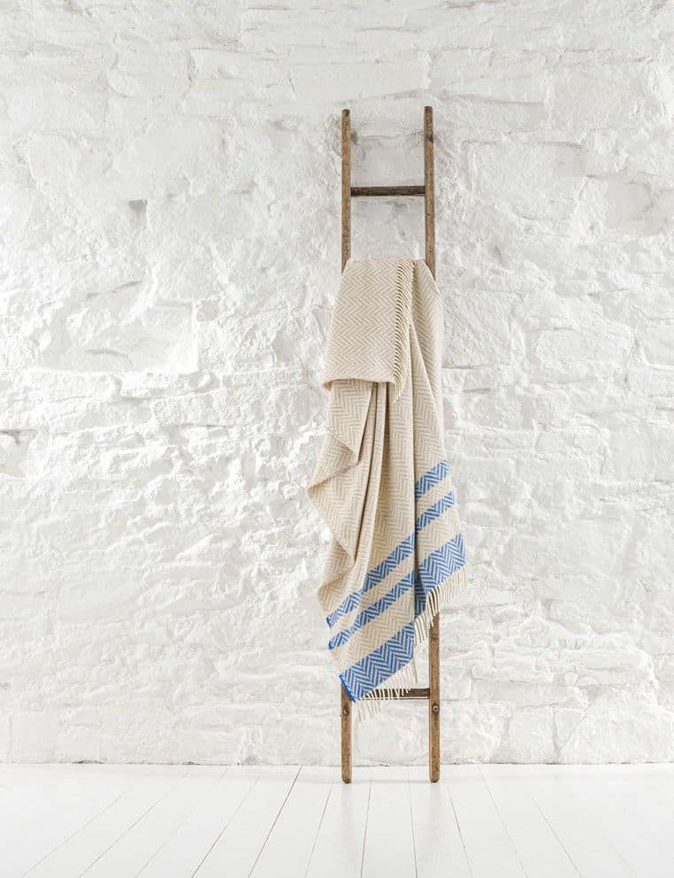 coastal interiors striped recycled wool throw in pale blue and natural cream by ian mankin #coastal #interiors #throw #recycled #wool #stripes