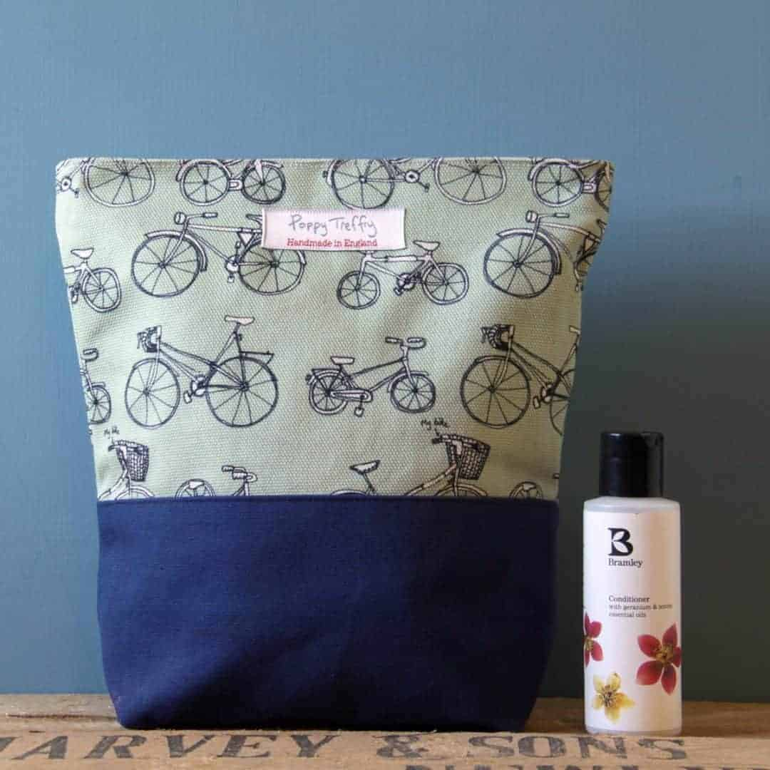 love this handmade bicycle print washbag by poppy treffry made in Cornwall england
