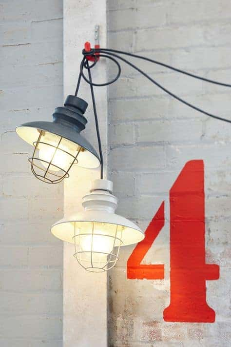 love this industrial coastal style ships lighting. White painted brick walls and fab graphic number 4. Click through for more contemporary coastal style ideas you'll love