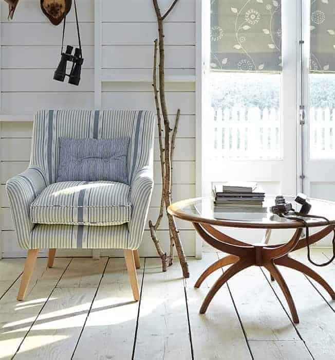 love this blue and white stripe linen covered armchair by vanessa arbuthnott. perfect for calm and contemporary coastal interiors