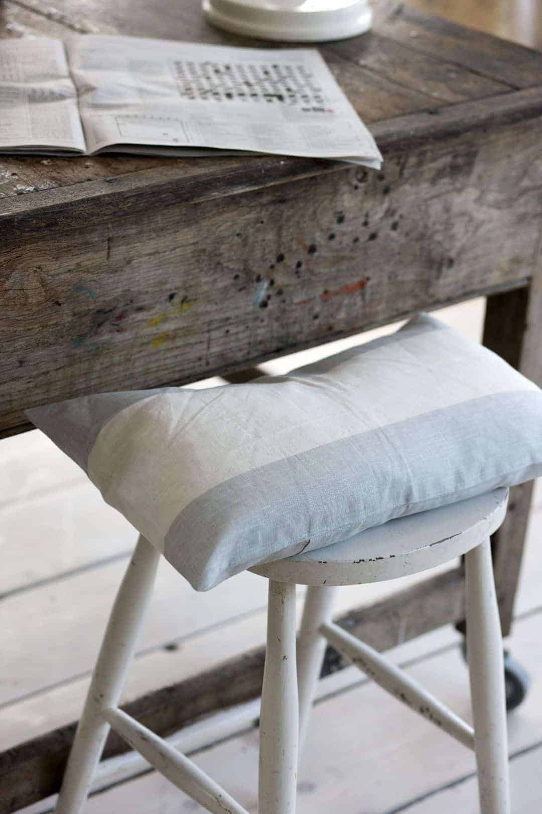 love this pale blue and white broad stripe cushion by cabbages & roses. Click through for more details and for other coastal and seaside interiors ideas you'll love