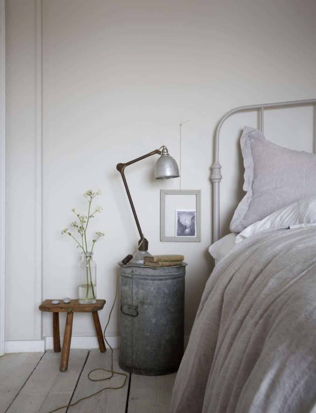 love this simple rustic seaside coastal bedroom with whitewashed floorboards industrial lamp and galvanised metal table and pale grey walls