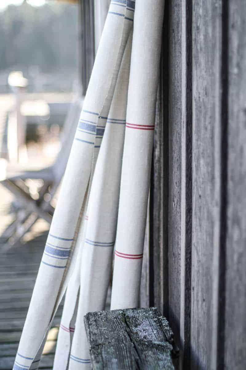 love this striped linen by Peony & Sage in blue stripe and red stripe on natural linen. Click through for more details and for other coastal and seaside interiors ideas you'll love