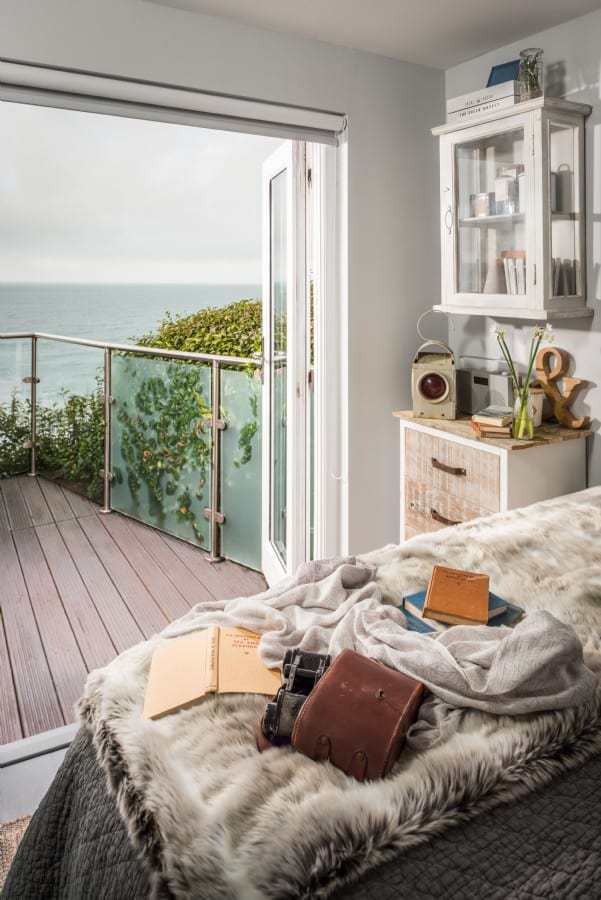 love this seaside interiors vintage rustic bedroom with modern balcony terrace. Click through for more seaside coastal bedroom ideas you'll love