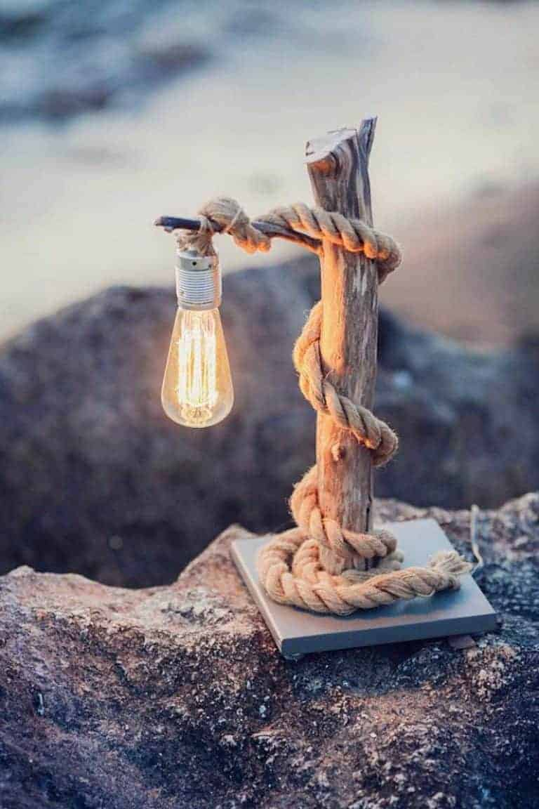 driftwood craft ideas - click through for inspiration like this beautiful driftwood and rope industrial style lamp