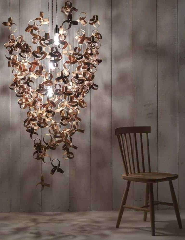 love this giant flock chandelier lighting pendant by Tom Raffield hand made using sustainable wood - ash, oak and walnut - in Cornwall. Click through to see other beautiful iconic designs by Tom Raffield you'll love to discover as well as to get all the info you need to connect with and shop from Tom Raffield