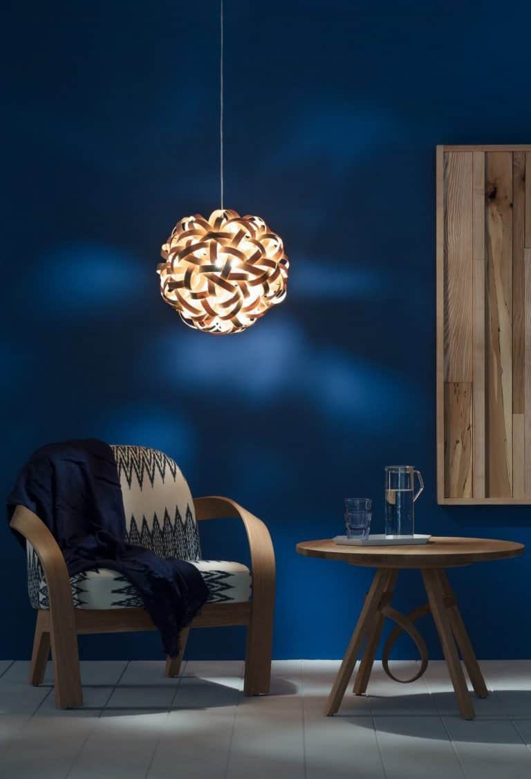 love this no 1 pendant light in natural wood against a dark blue background by tom raffield, using steam bent sustainable timber to create award winning lighting by tom raffield design - all handmade in Cornwall and iconic designs set to become classics. Click through to see other beautiful designs by Tom Raffield we love and think you'll love too