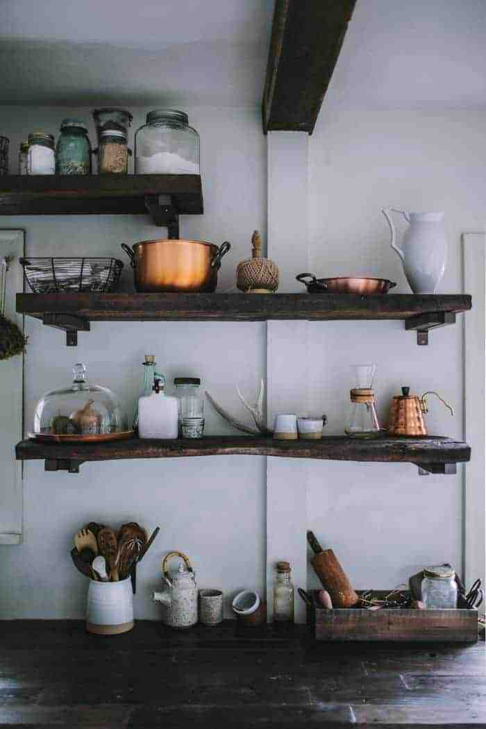 love this future kept modern rustic kitchen with open rustic wooden shelves, copper accessories and rustic ceramics. Click through for more modern rustic country interiors you'll love