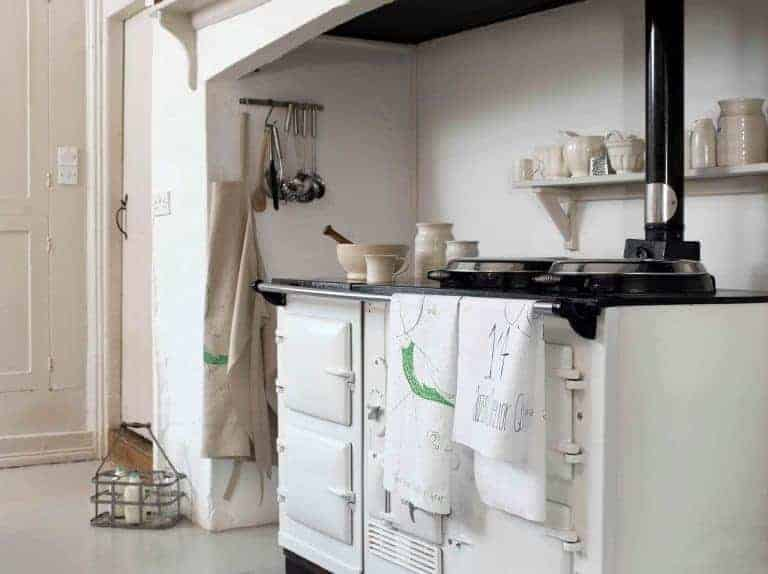 love this modern rustic white country kitchen with white aga and white on white country kitchen. Click through for inspiring white on white interiors ideas you'll love