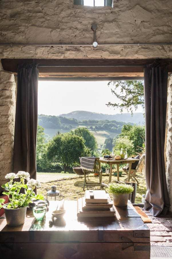 love this modern rustic barn farmhouse with bifold french doors and views to the terrace and rustic brick floor. Click through for more modern rustic farmhouse interiors ideas you'll love