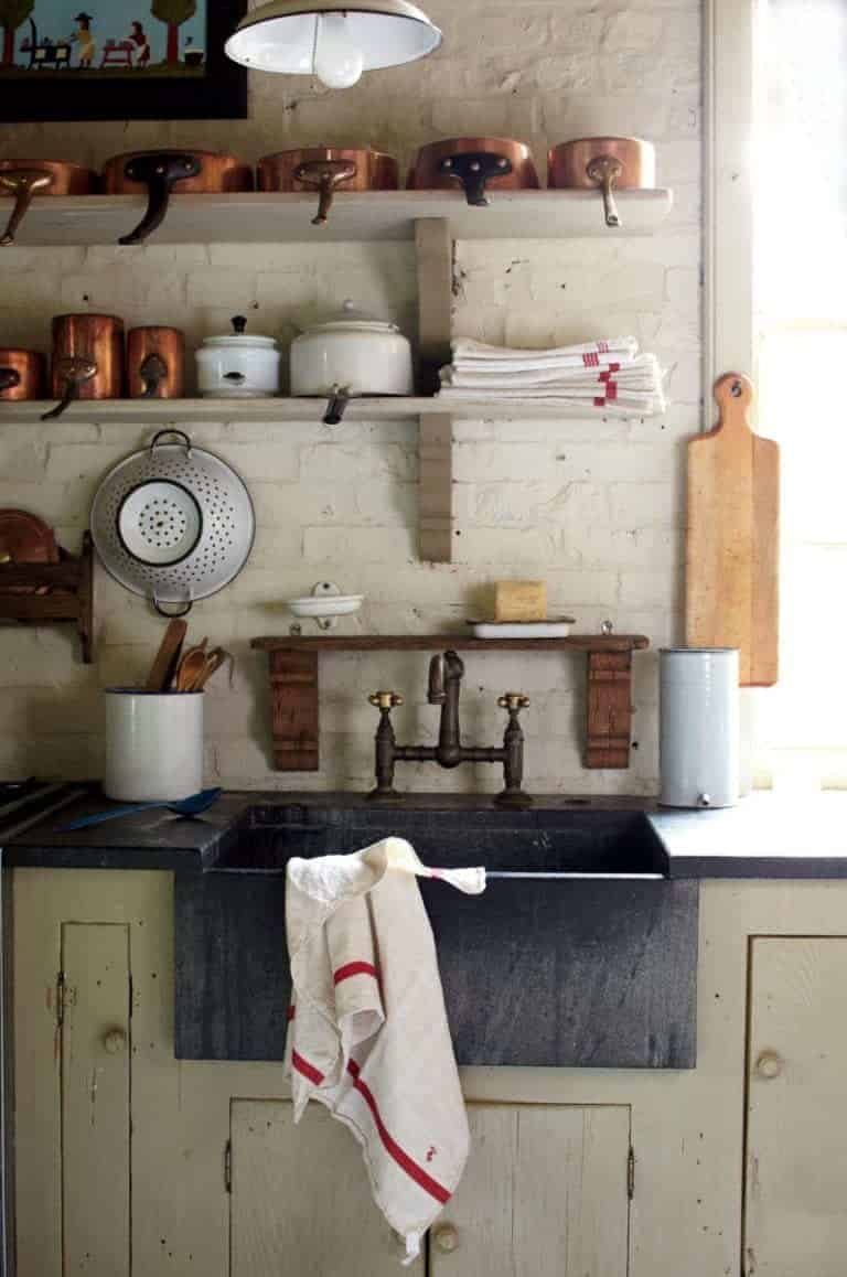 love this country rustic kitchen with open shelves, shaker cupboards and vintage enamel and wood. Click through for more rustic interiors ideas you'll love