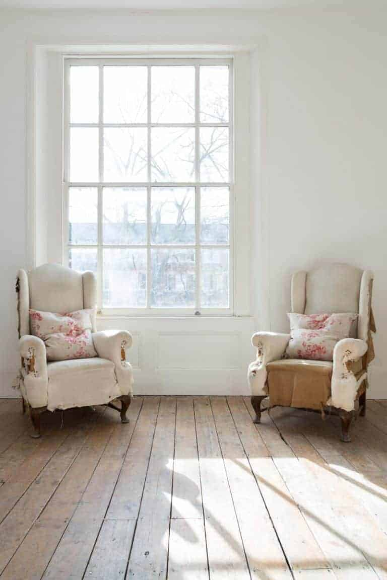 love these modern rustic distressed armchairs with pretty linen cushions by cabbages & roses