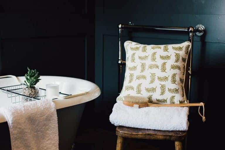love this modern rustic bathroom with walls painted in farrow and ball railings bathroom looks contrasted with white rolltop bath and printed linens