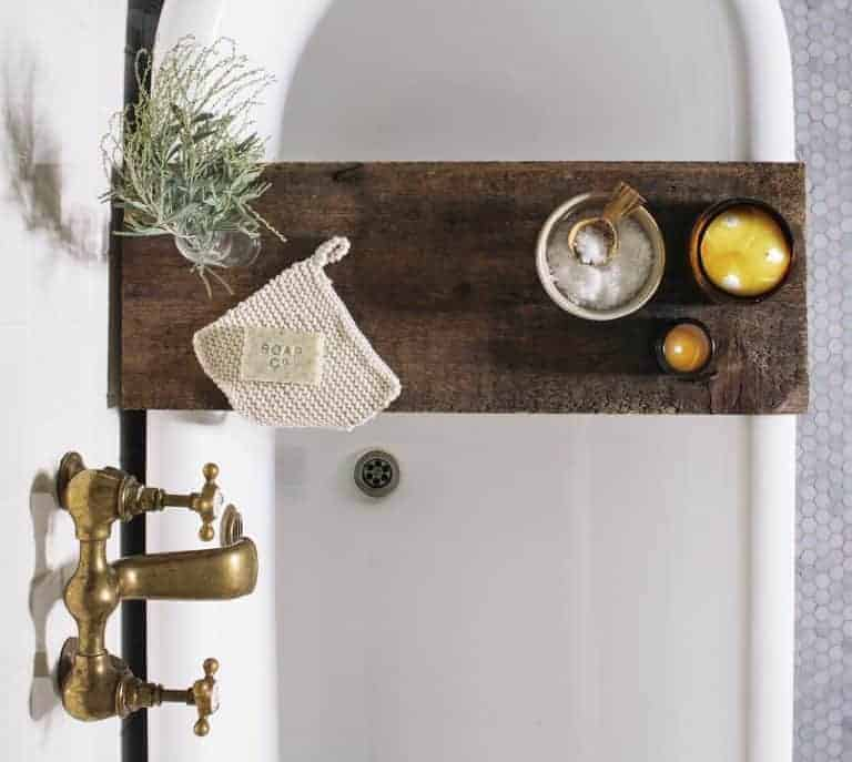 love how rustic dark wood shelf works across white rolltop bath in modern rustic bathroom