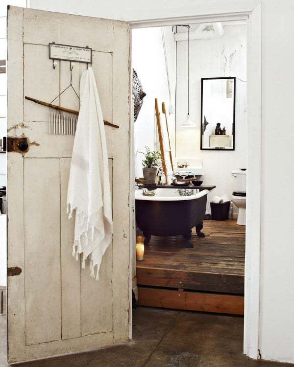 love this modern rustic bathroom with wood floor roll top bath and white walls