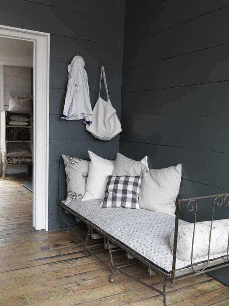 love this modern rustic daybed with dark grey wall and simple white and grey linens