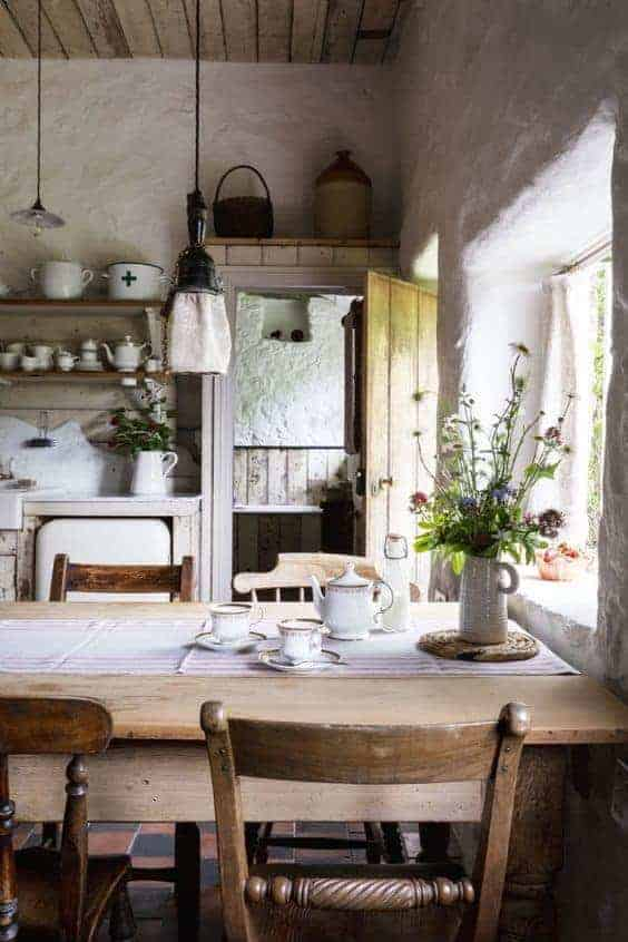 love this modern rustic country farmhouse kitchen dining room with reclaimed wooden cupboards, rustic wooden table, open shelves, rustic white-washed walls and tiled floor. Click through for more modern rustic farmhouse interiors ideas you'll love