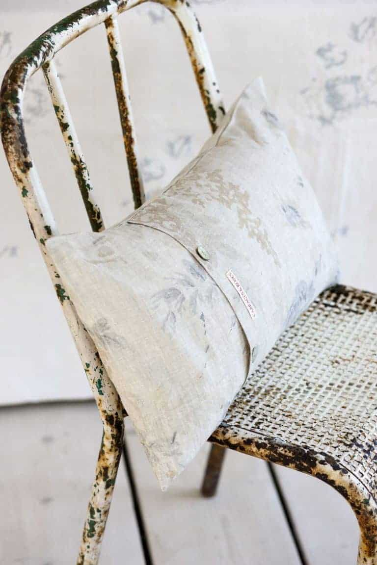 love this modern rustic rusted metal chair with linen cushion