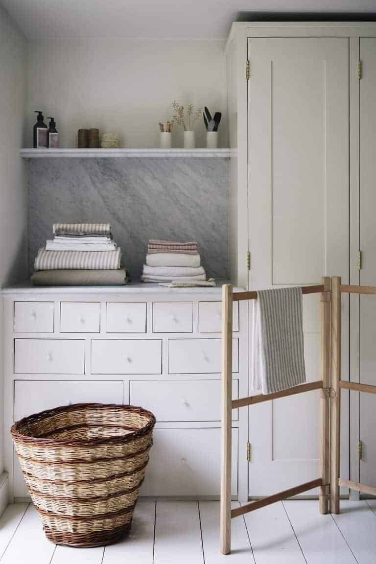 love this modern rustic utility laundry room with open shelves, marble splashback, painted vintage cupboard linen press and wooden airer