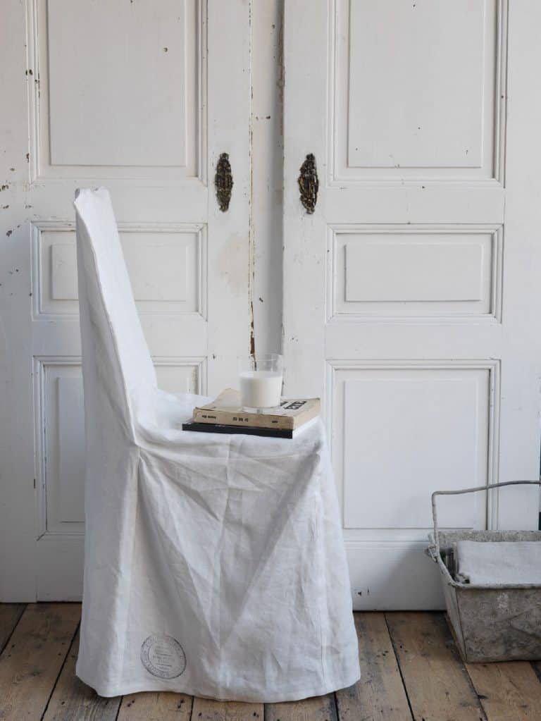 love this modern rustic white linen covered chair