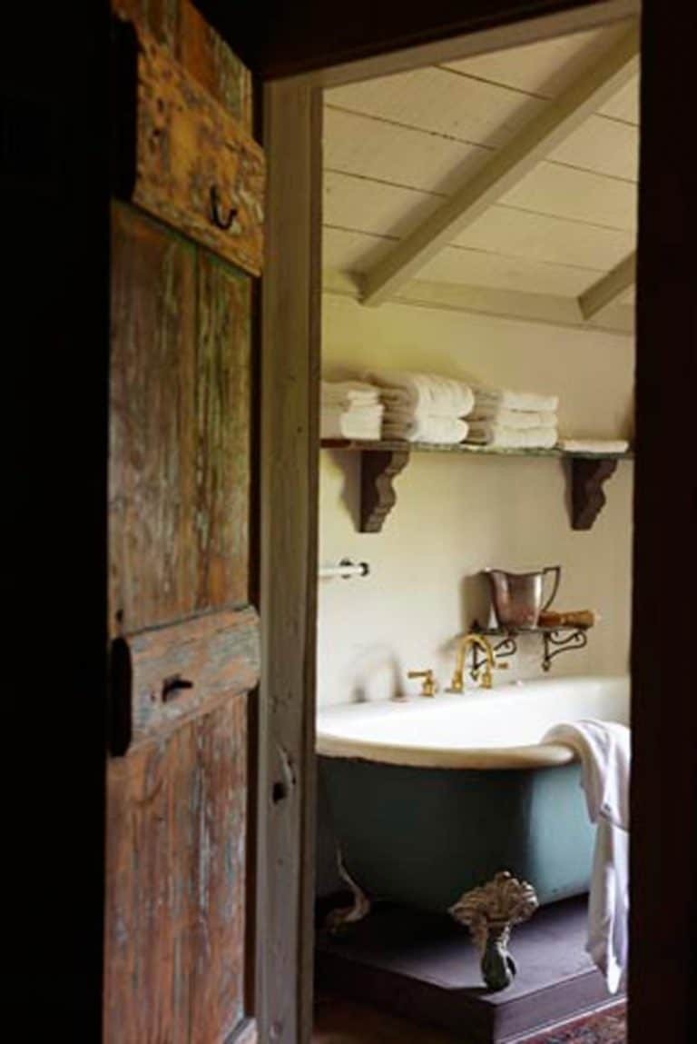 love this rustic country bathroom with roll top bath, open shelves and rustic wood