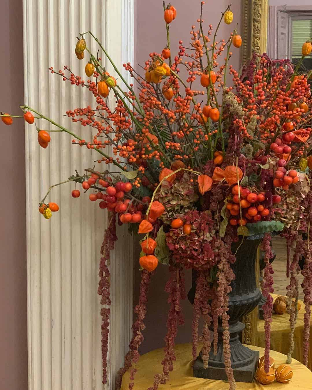love these bright orange and red autumn flowers with chinese lantern and red berries by Kate Langdale click through for loads more creative autumn flower ideas you'll love