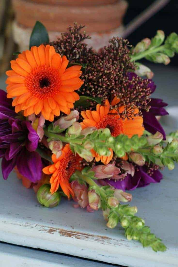 how to arrange stunning autumn flowers and halloween pumpkin decorations with Sussex Flower School. Click through for inspiring autumn flower arrangement ideas you'll love