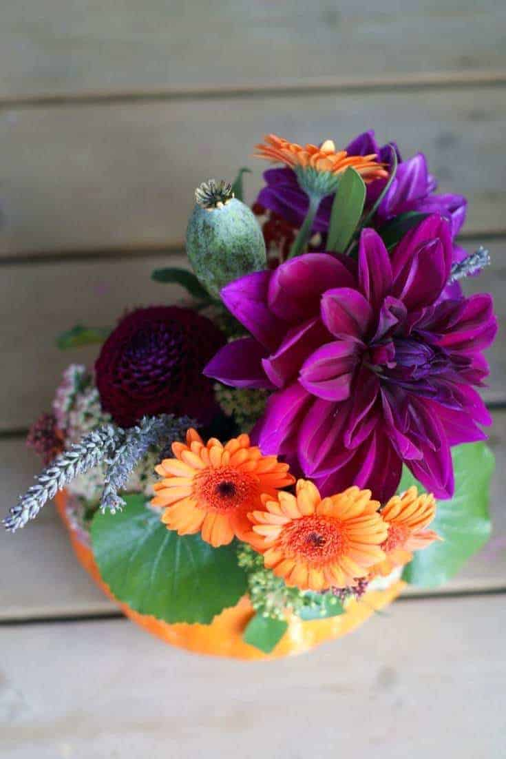 how to make an autumn halloween flower pumpkin decoration: how to arrange stunning autumn flowers with Sussex Flower School. Click through for inspiring autumn flower arrangement ideas you'll love
