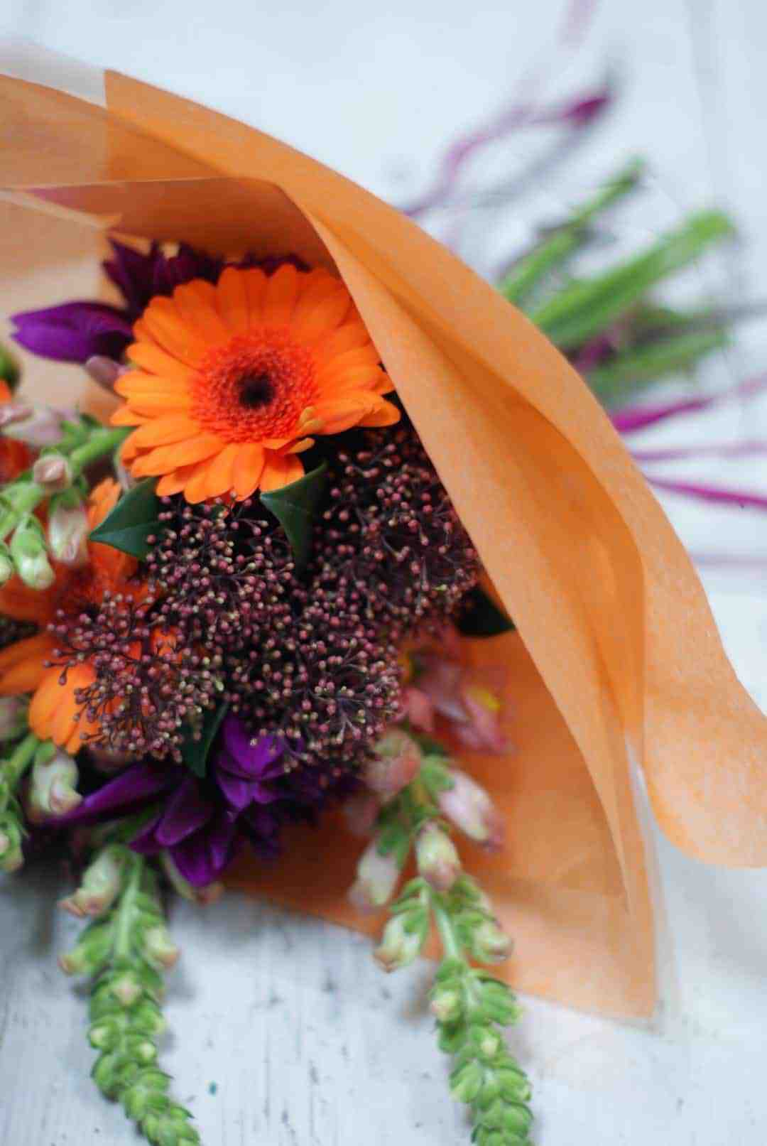 how to arrange stunning autumn flowers and halloween pumpkin decorations: autumn orange and purple flower hand tied bouquet - how to make it