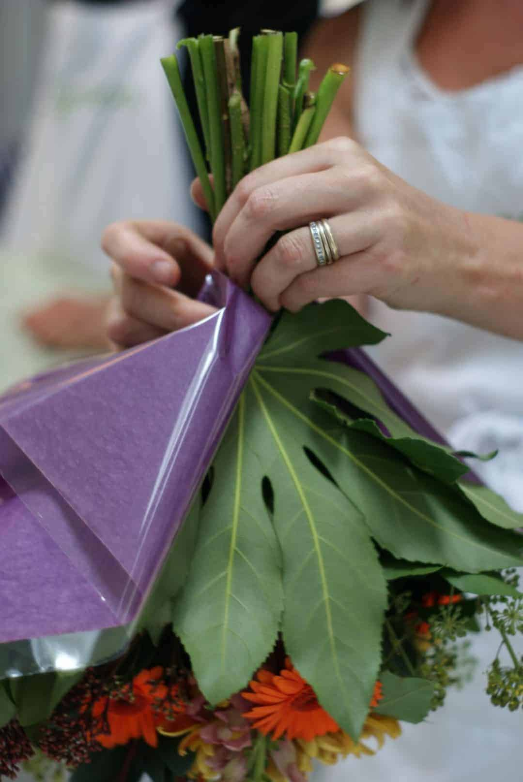 how to wrap cellophane and paper around hand tied bouquet