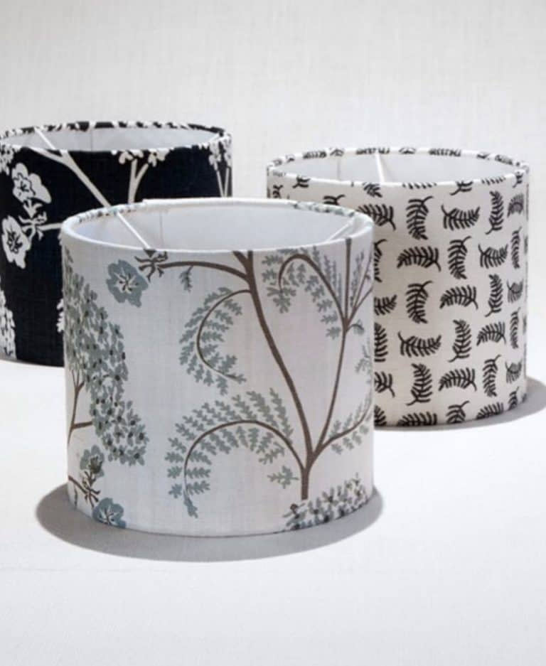 love these linen lampshades covered in pretty floral and sprig patterns by madder cutch and co