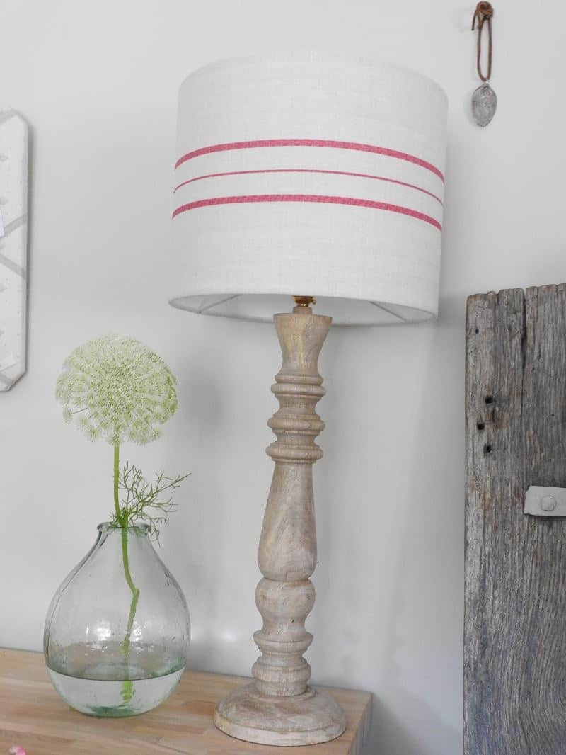 love this handmade linen red stripe shade by Peony & Sage. Click through to find out more and to discover other beautiful linen lampshades made in the UK that you'll love