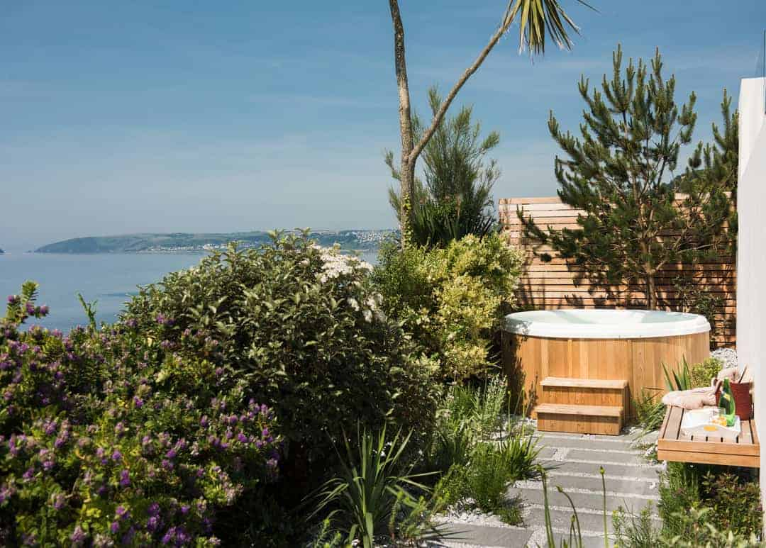 wooden hot tub at sea edge downderry cornwall beach house