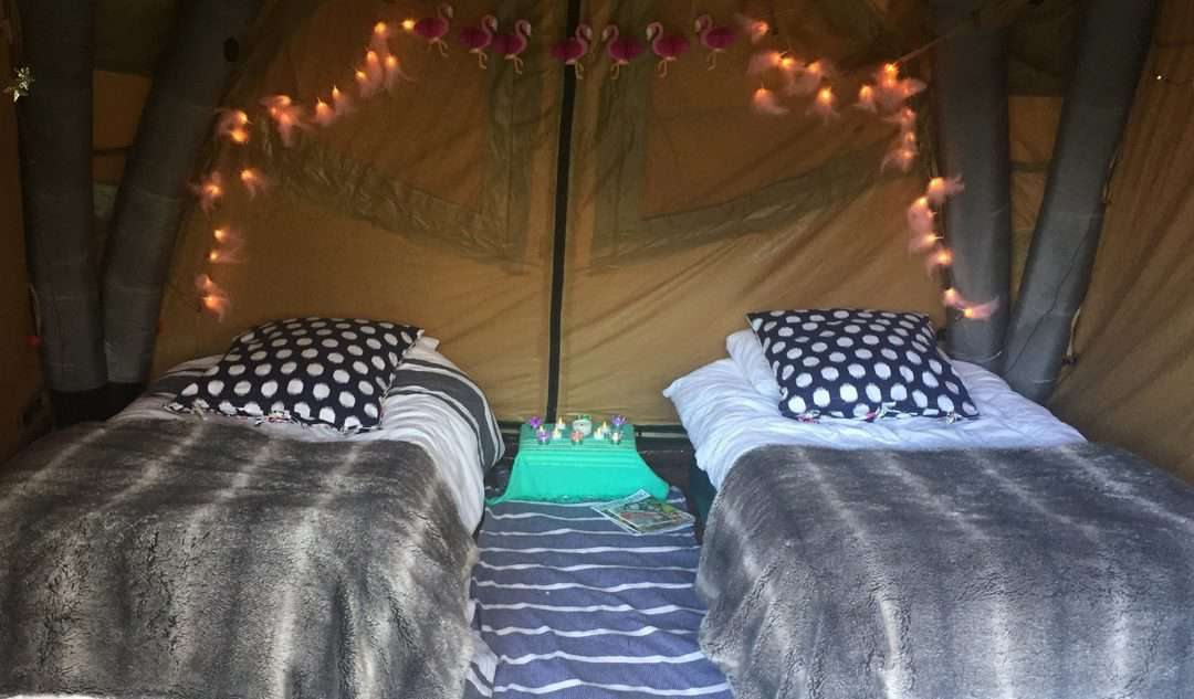 how to decorate your tent for a festival with lights, throws and rugs