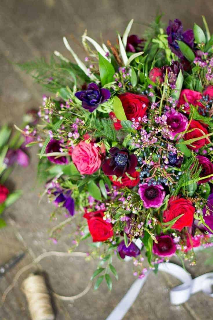 how to create winter wedding country flowers. We love these red, purple and deep berry shades. Click through for more inspiring ideas from our favourite growers and florists