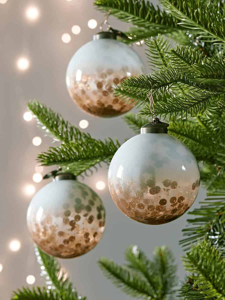 love these handmade milky glass baubles with copper and sequins inside by somerset based Cox & Cox. click through for more special christmas decorations you'll love to hang year after year