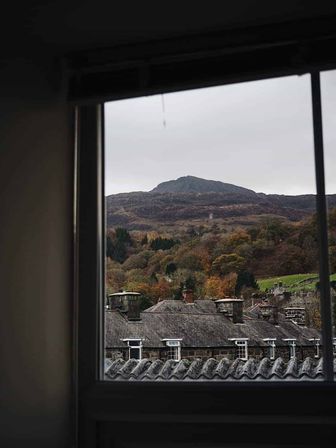 Love this moody window image with welsh mountain view. Slow living in Snowdonia - meet creative business coach, marketing mentor and blogger Simple and Season Kayte Ferris. She shares a little of the story behind her slow living lifestyle in Snowdonia as well as tips for achieving a more soulful lifestyle wherever you live