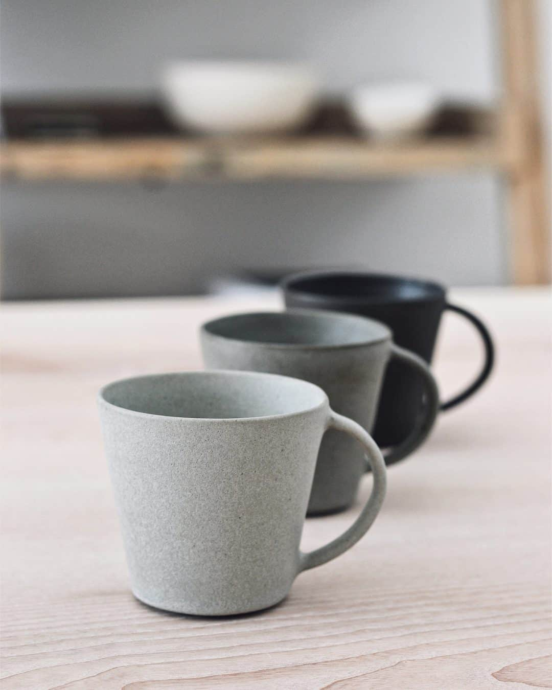 Minimalist handmade ceramic mugs in black and grey by Jono Smart. One of Sara Tasker's favourite gift ideas this year. Click through to discover Sara's other favourites - you'll love them!