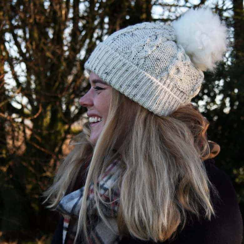 aran beanie bobble hat with sheepskin pompom made in britain by Glencroft - just one of my favourite sustainable gardening gift ideas #gardening #giftideas #gifts #sustainable #gardeners #madeinbritain
