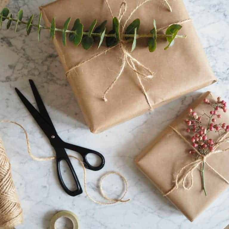 love this simple brown paper and string christmas gift wrapping idea with pink peppercorns and foliage. It's by 91 magazine editor Caroline Rowland. Click through for more festive ideas you'll love...