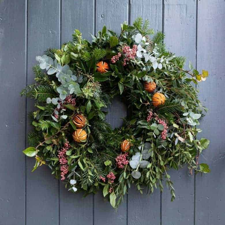 where to buy this contemporary christmas wreath eucalpytus, ivy, bay, pink peppercorns, dried citrus fruit and eco friendly moss #christmas #wreath #ecofriendly #oranges #citrus #fruit #foraged #frombritainwithlove