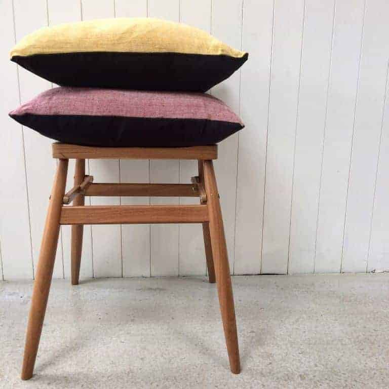 Aerende organic cotton and linen cushions made by refugees