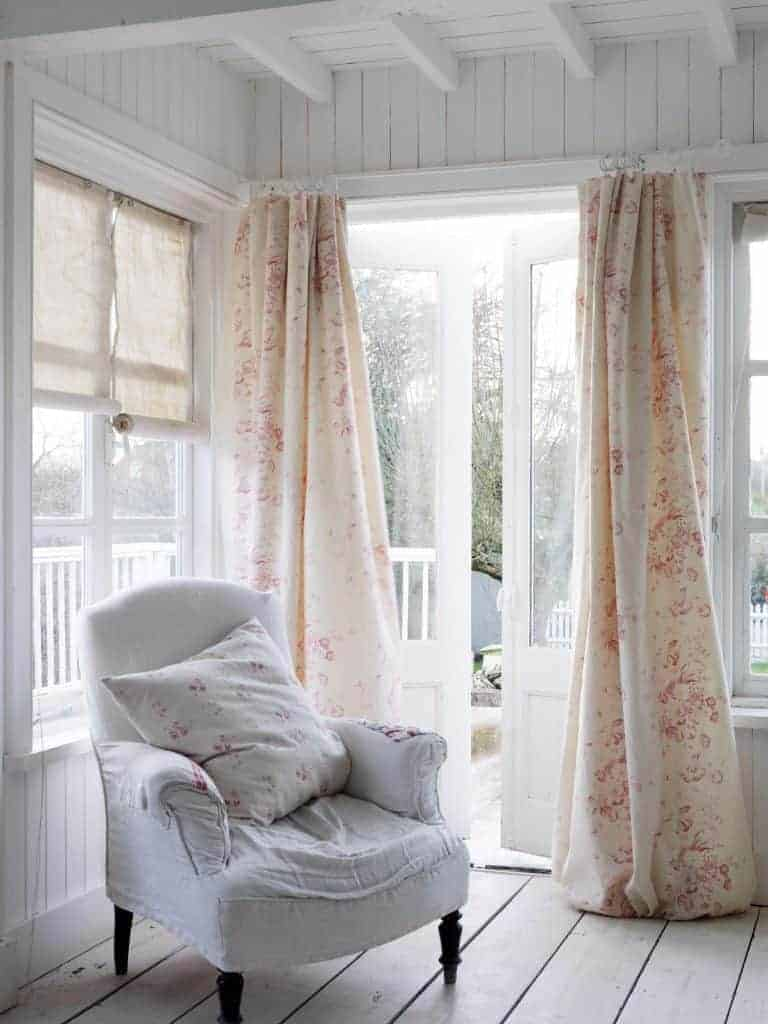 love these faded floral linen curtains by cabbages and roses